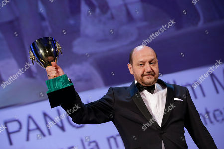 Themis Panou Actor Themis Panou holds his Volpi Cup for Best Actor for his role in the film Miss Violence, during the awards ceremony of the 70th edition of the Venice Film Festival in Venice, Italy