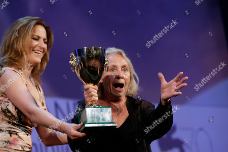 Elena Cotta Jury member Martina Gedeck, left, presents actress Elena Cotta with the Volpi Cup for Best Actress,for her role in the film Via Castellana Bandiera, during the awards ceremony of the 70th edition of the Venice Film Festival in Venice, Italy