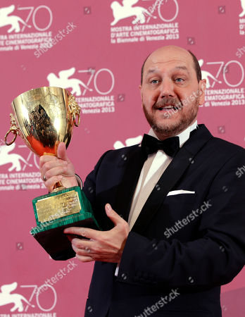 Themis Panou Actor Themis Panou holds his Volpi Cup for Best Actor for his role in the film Miss Violence during the awards photo call at the 70th edition of the Venice Film Festival in Venice, Italy