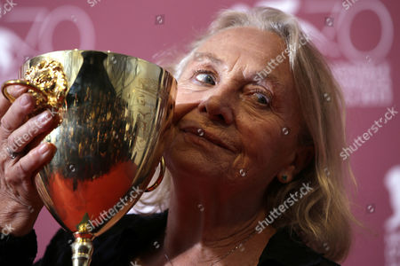 Elena Cotta Actress Elena Cotta holds her Volpi Cup for Best Actress for her role in the film Via Castellana Bandiera, during the awards photo call at the 70th edition of the Venice Film Festival in Venice, Italy