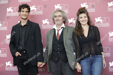 Louis Garrel, Philippe Garrel, Esther Garrel From left, actor Louis Garrel, director Philippe Garrel and actress Esther Garrel pose for photographers during the photo call of the film 'La jalousie', at the 70th edition of the Venice Film Festival held from Aug. 28 through Sept. 7, in Venice, Italy