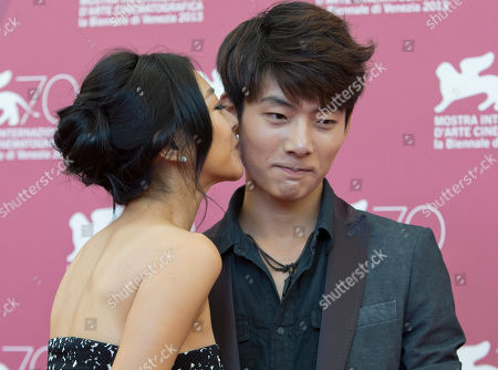 Seo Young-ju, Lee Eun-woo Actress Lee Eun-woo, left, kisses actor Seo Young-ju as they pose during a photo call for the movie 'Moebius' at the 70th edition of the Venice Film Festival held from Aug. 28 through Sept. 7, in Venice, Italy