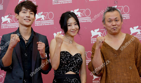 Kim Ki-duk, Seo Young-ju, Lee Eun-woo From left, actors Seo Young-ju, Lee Eun-woo, and director Kim Ki-duk pose during a photo call for the movie 'Moebius' at the 70th edition of the Venice Film Festival held from Aug. 28 through Sept. 7, in Venice, Italy