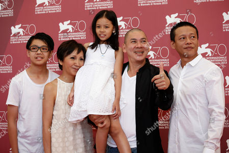From left, actors Lee Yi-cheng, Lu Yi-ching, Lee Yi-chieh, director Ming Liang Tsai and actor Lee Kang-sheng pose for photographers at the the Stray Dogs photo call during the 70th edition of the Venice Film Festival held from Aug. 28 through Sept. 7, in Venice, Italy