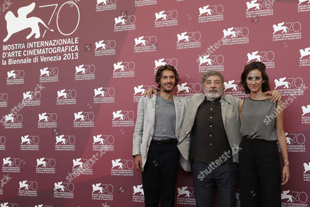 Gabriele Rendina, Livia Rossi, Gianni Amelio From left, actor Gabriele Rendina, director Gianni Amelio and actress Livia Rossi pose for photographers at the photo call for the film The Intrepid at the 70th edition of the Venice Film Festival held from Aug. 28 through Sept. 7, in Venice, Italy