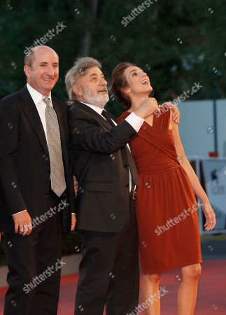 Gianni Amelio, Livia Rossi, Antonio Albanese Fom left, actor Antonio Albanese, director Gianni Amelio and actress Livia Rossi pose for photographers on the red carpet for the film The Intrepid at the 70th edition of the Venice Film Festival held from Aug. 28 through Sept. 7, in Venice, Italy