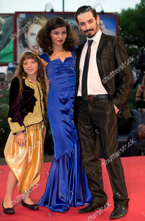 Meriem Medjkane, Myriam Ait El-Hadj, Nadjib Oulebsir From left, actors Myriam Ait El-Hadj, Meriem Medjkane and Nadjib Oulebsir arrive for the screening of the film 'The Roof-Tops' at the 70th edition of the Venice Film Festival held from Aug. 28 through Sept. 7, in Venice, Italy