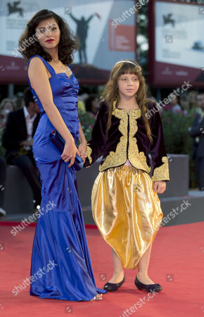Meriem Medjkane, Myriam Ait El-Hadj Actresses Meriem Medjkane, left, and Myriam Ait El-Hadj arrive for the screening of the film 'The Roof-Tops' at the 70th edition of the Venice Film Festival held from Aug. 28 through Sept. 7, in Venice, Italy