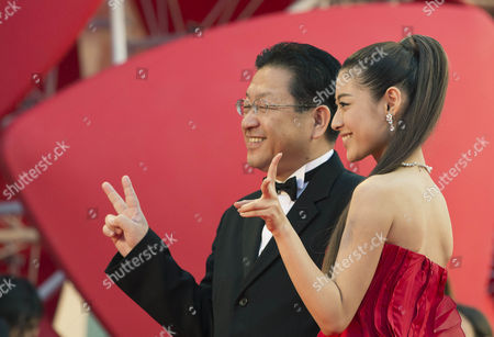 Miori Takimoto, Koji Hoshino Actress Miori Takimoto, right, arrives with Studio Ghibli President Koji Hoshino for the screening of the movie 'The Wind Rises' at the 70th edition of the Venice Film Festival held from Aug. 28 through Sept. 7, in Venice, Italy