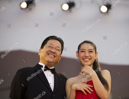 Stock Image of Mori Takimoto, Koji Hoshino Actress Miori Takimoto, right, arrives with Studio Ghibli President Koji Hoshino for the screening of the movie 'The Wind Rises' at the 70th edition of the Venice Film Festival held from Aug. 28 through Sept. 7, in Venice, Italy