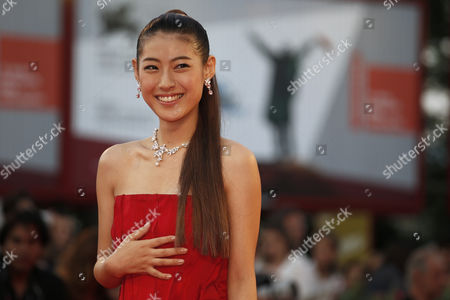 Miori Takimoto Actress Miori Takimoto laughs as she poses for photographers during the red carpet for the film The Wind Rises at the 70th edition of the Venice Film Festival held from Aug. 28 through Sept. 7, in Venice, Italy