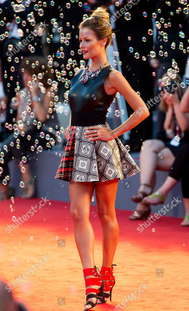 Model Natalia Borges poses on the red carpet for the screening of the film Tracks, at the 70th edition of the Venice Film Festival held from Aug. 28 through Sept. 7, in Venice, Italy