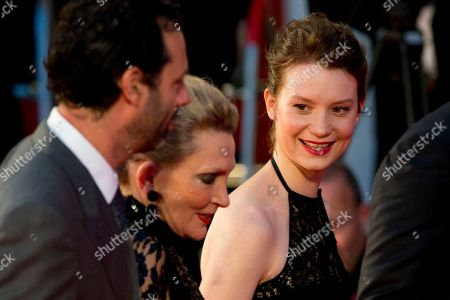 Mia Wasikowska, Robyn Davidson, Emile Sherman From right, actress Mia Wasikowska, writer Robyn Davidson and Emile Sherman arrive on the red carpet for the screening of their film Tracks, at the 70th edition of the Venice Film Festival held from Aug. 28 through Sept. 7, in Venice, Italy