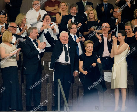 Lech Walesa, Miroslawa Danuta Walesa Former Polish President Lech Walesa, centre, is flanked by his wife Miroslawa Danuta Walesa, as he acknowledges the ovation before the screening of the movie 'Walesa. Man Of Hope' at the 70th edition of the Venice Film Festival held from Aug. 28 through Sept. 7, in Venice, Italy