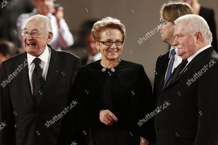 From right, former Polish President Lech Walesa, his wife Miroslawa Danuta Walesa and director Andrzej Wajda pose for photographers during the red carpet for the film Walesa. Man Of Hope at the 70th edition of the Venice Film Festival held from Aug. 28 through Sept. 7, in Venice, Italy
