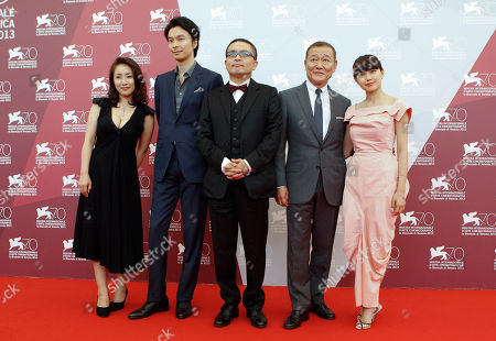 Megumi Kagurazaka, Hiroki Hasegawa, Sion Sono, Jun Kunimura, Fumi Nikaido The cast of the movie 'Why Don't You Play In Hell', from left, actors Megumi Kagurazaka, Hiroki Hasegawa, director Sion Sono, actors Jun Kunimura and Fumi Nikaido pose during a photo call at the 70th edition of the Venice Film Festival held from Aug. 28 through Sept. 7, in Venice, Italy