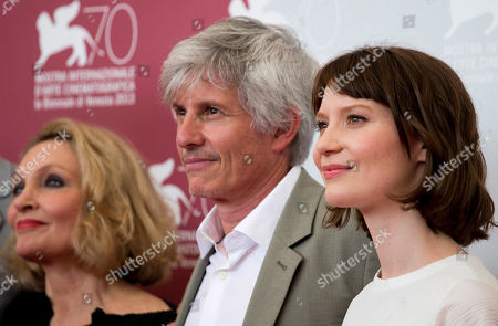 John Curran, Robyn Davidson, John Curran From left, author Robyn Davidson, director John Curran, and actress Mia Wasikowska pose for photographers during a photo call for the film Tracks at the 70th edition of the Venice Film Festival held from Aug. 28 through Sept. 7, in Venice, Italy