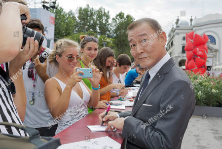 Jun Kunimura Actor Jun Kunimura signs autographs as he arrives for the screening of the movie 'Why Don't You Play In Hell' at the 70th edition of the Venice Film Festival held from Aug. 28 through Sept. 7, in Venice, Italy