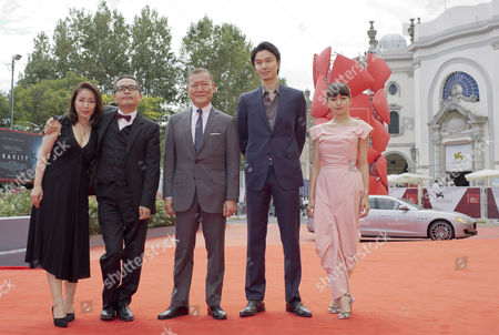 Jun Kunimura, Megumi Kagurazaka, Sion Sono, Hiroki Hasegawa, Fumi Nikaido The cast of the movie 'Why Don't You Play In Hell', from left, actress Megumi Kagurazaka, director Sion Sono, actors Jun Kunimura, Hiroki Hasegawa, and Fumi Nikaido pose as they arrive for the screening of their movie at the 70th edition of the Venice Film Festival held from Aug. 28 through Sept. 7, in Venice, Italy