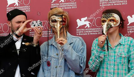 Stock Picture of Lukas Moodyson, Liv LeMoyne, Mira Grosin Director Lukas Moodyson takes a photograph, whilst actresses Liv LeMoyne and Mira Grosin wear Venetian carnival masks during the photo call for the film We Are The Best during the 70th edition of the Venice Film Festival held from Aug. 28 through Sept. 7, in Venice, Italy