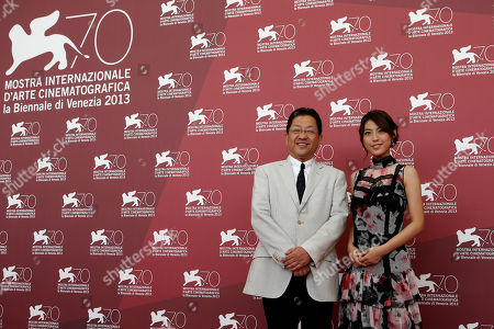 Stock Photo of Miori Takimoto, Koji Hoshino From left, Studio Ghlibi president Koji Hoshino and actress Miori Takimoto pose for photographers during the photo call for the film The Wind Rises at the 70th edition of the Venice Film Festival held from Aug. 28 through Sept. 7, in Venice, Italy