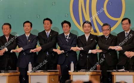 Ichiro Ozawa, Natsuo Yamaguchi, Banri Kaieda, Shinzo Abe, Toru Hashimoto, Yoshimi Watanabe, Kazuo Shii Leaders of Japan's nine political parties take their hands together at the start of their debate for upper house elections to be held on July 21 at the Japan National Press Club in Tokyo . They are from left, Ichiro Ozawa of the People's Lives First Party, Natsuo Yamaguchi of the New Komeito Party, Banri Kaieda of the Democratic Party of Japan, Prime Minister Shinzo Abe of the Liberal Democratic Party, Toru Hashimoto of the Japan Restoration Party, Yoshimi Watanabe of Your Party and Kazuo Shii of the Communist Party