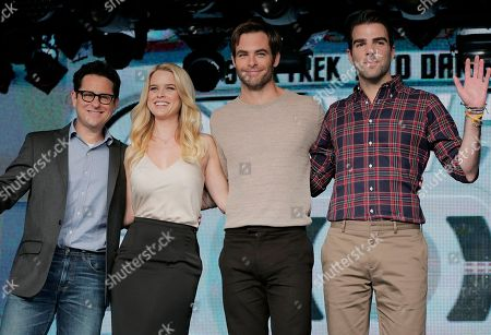 "J. J. Abrams, Alice Eve, Chris Pine, Zachary Quinto Director J.J. Abrams, left, British actress Alice Eve, second left, U.S actors, Chris Pine, third left, and Zachary Quinto, pose for photographers during a press conference for their film ""Star Trek Into Darkness"" in Tokyo"
