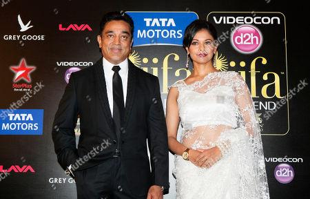 Kamal Haasan, Diana Penty Bollywood actors Kamal Haasan, left, and Diana Penty arrive for the International Indian Film Academy (IIFA) awards in Macau
