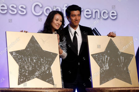 "Zhang Ziyi, Wang Leehom Chinese actress Zhang Ziyi and American-Taiwanese actor-singer Wang Leehom pose with their hand prints for photographers during a press conference to promote their movie ""My Lucky Star"" in Macau"