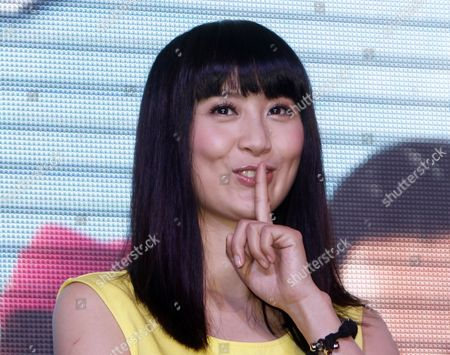 """Stock Picture of Fala Chen Hong Kong actress Fala Chen gestures to her fans during Hong Kong TVB drama """"Triumph in the Skies 2"""" promotional event at a shopping mall in Petaling Jaya, near Kuala Lumpur, Malaysia"""