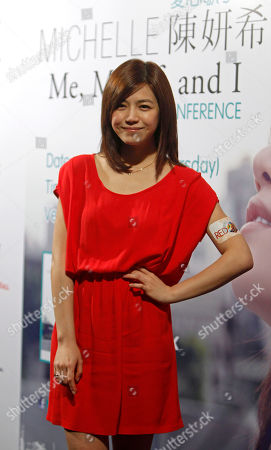 """Michelle Chen Taiwanese singer Michelle Chen poses for photographers during a press conference of her new album """"Me, Myself and I"""" in Kuala Lumpur, Malaysia"""