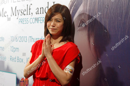 """Michelle Chen Taiwanese singer Michelle Chen gestures during a press conference of her new album """"Me, Myself and I"""" in Kuala Lumpur, Malaysia"""