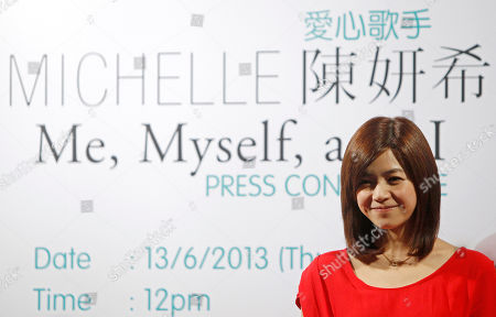 """Michelle Chen Taiwanese singer Michelle Chen smiles during a press conference of her new album """"Me, Myself and I"""" in Kuala Lumpur, Malaysia"""
