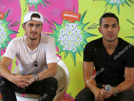 Stock Image of Kendal Schmidt, Carlos Pena Members of the American boy band, Big Time Rush, Kendal Schmidt, left and Carlos Pena listen to a reporter's question in the pressroom of the Nickelodeon's Kids' Choice Awards, in Mexico City
