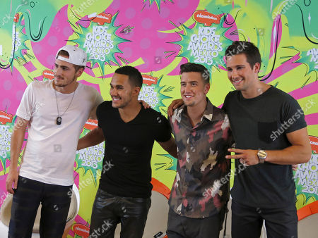 Stock Picture of Kendal Schmidt, Carlos Pena, Logan Henderson, James Maslow Members of the American boy band, Big Time Rush, from left to right, Kendal Schmidt, Carlos Peña, Logan Henderson and James Maslow pose for a photo in the pressroom of the Nickelodeon's Kids' Choice Awards, in Mexico City