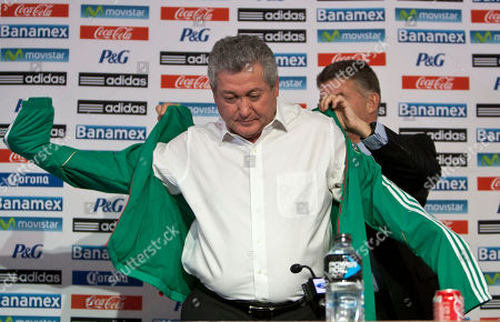"""Victor Manuel Vucetich, Hector Gonzalez Inarritu Victor Manuel Vucetich puts on his new team's jacket with the help of Hector Gonzalez Inarritu, the director of Mexico's national soccer teams, as Vucetich is named the new coach for Mexico's national soccer team in Mexico City, . Vucetich is one of the most successful coaches in the local league, where he´s known as """"King Midas"""" after winning 14 of 15 the finals he has managed in his career. He replaces Jose Manuel De la Torre who was fired on Saturday after a loss to Honduras"""