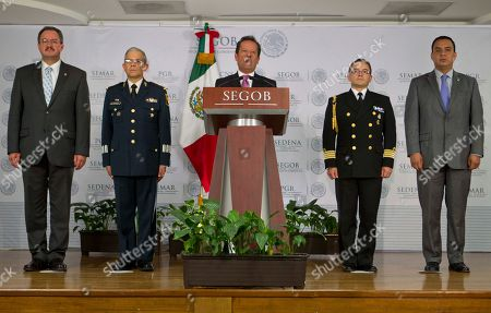 Mexico's government spokesman Eduardo Sanchez, center, speaks during a news conference flanked by Rodrigo Archundia. left, of the Attorney General's office, Gen. Martin Terrones, second from left, spokesman of the Defense Ministry, Navy Capt. Jorge Vazquez, second from right, spokesman of the Mexican Navy and Carlos Cervantes, Commissioner for National Security and Federal Police in Mexico City, . Sanchez announced that Miguel Angel Trevino Morales, the notoriously brutal leader of the Zetas drug cartel, was captured by Mexican Marines before dawn Monday after being intercepted in a pickup truck with $2 million in cash on a dirt road in the countryside outside the border city of Nuevo Laredo, which has long served as their base of operations