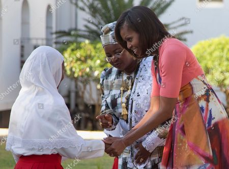Michelle Obama, Salma Kikwete First lady Michelle Obama and Tanzanian first lady Salma Kikwete greet a girl who presented flowers to place on the Embassy Bombing Memorial at the National Museum in Dar es Salaam, Tanzania, . Tanzania, which along with Nairobi was the site of near-simultaneous embassy attacks in August 1998