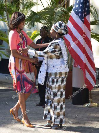 Michelle Obama, Salma Kikwete First lady Michelle Obama is greeted by Tanzanian first lady Salma Kikwete at the State House in Dar es Salaam, Tanzania