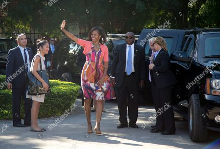 Michelle Obama First lady Michelle Obama waves as she arrives by motorcade to meet Tanzanian first lady Salma Kikwete at the State House in Dar es Salaam, Tanzania