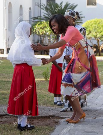 Michelle Obama, Salma Kikwete First lady Michelle Obama, accompanied by Tanzanian first lady Salma Kikwete, greets the girl who presented her with flower to place at the Embassy Bombing Memorial at the National Museum, in Dar es Salaam, Tanzania, . Tanzania, which along with Nairobi was the site of near-simultaneous embassy attacks in August 1998