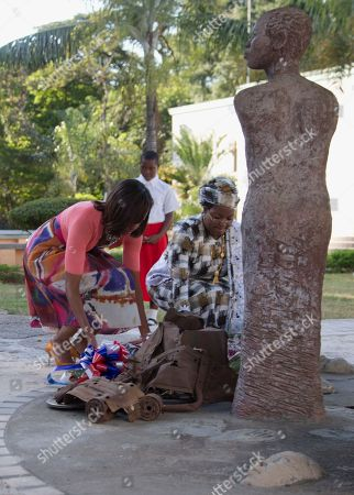 Michelle Obama, Salma Kikwete First lady Michelle Obama and Tanzanian first lady Salma Kikwete place flowers at the Embassy Bombing Memorial at the National Museum in Dar es Salaam, Tanzania, . Tanzania, which along with Nairobi was the site of near-simultaneous embassy attacks in August 1998