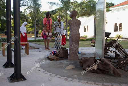 Michelle Obama, Salma Kikwete First lady Michelle Obama and Tanzanian first lady Salma Kikwete pause after placing flowers at the Embassy Bombing Memorial at the National Museum, in Dar es Salaam, Tanzania. Tanzania, which along with Nairobi was the site of near-simultaneous embassy attacks in August 1998