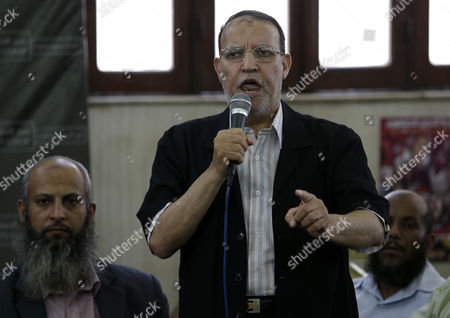 "Essam el-Erian, deputy head of the Brotherhood's political party, speaks during a press conference at Rabiah al-Adawiya mosque, in Nasr city, Cairo, Egypt, . On Monday, a senior Brotherhood figure escalated the group's campaign against the United States, calling on protesters to ""besiege"" the embassy and expel the ambassador. El-Erian, said Monday, ""the American role in the coup is very clear and no one can hide"