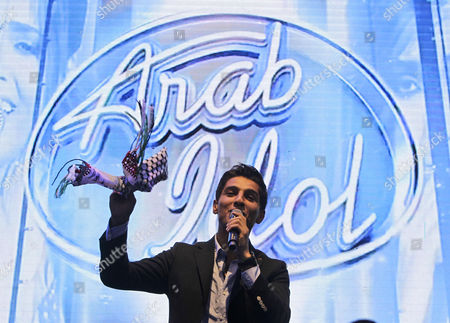 Stock Photo of Mohammad Assaf Arab Idol Mohammad Assaf, a 23 year old singer from Gaza, performs for his fans at MBC television headquarters in Dubai, United Arab Emirates