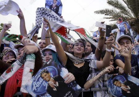 Stock Picture of Mohammad Assaf Fans of Arab Idol Mohammad Assaf, a 23 year old singer from Gaza, sing for him after he arrived at the MBC television headquarters in Dubai, United Arab Emirates