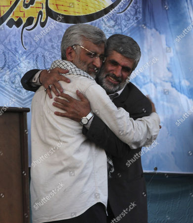 Saeed Jalili Rahim Ahmadi Roshan Iranian top nuclear negotiator and presidential candidate Saeed Jalili, left, embraces Rahim Ahmadi Roshan, the father of a slain Iranian scientist, Mostafa Ahmadi Roshan during a campaign rally, two days prior to the election, in Tehran, Iran, Mostafa Ahmadi Roshan, a chemistry expert and a director of the Natanz uranium enrichment facility, was killed in a bomb blast in 2012