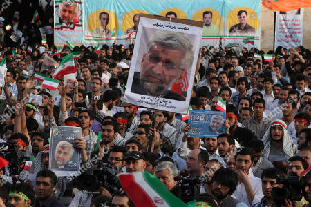 Supporters of Iranian top nuclear negotiator and presidential candidate Saeed Jalili attend a campaign rally, two days prior to the presidential election, in Tehran, Iran
