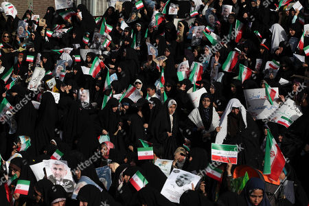 Female supporters of the Iranian presidential candidate Saeed Jalili, Iran's top nuclear negotiator, attend a campaign rally, two days prior to the election, in Tehran, Iran