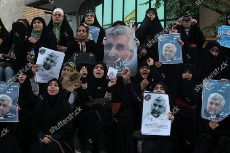 Female supporters of the Iranian presidential candidate Saeed Jalili, Iran's top nuclear negotiator, chant slogans, in a campaign rally, two days prior to the election, in Tehran, Iran